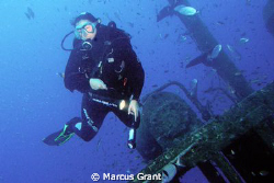 A diver on the wreck of the Rozi by Marcus Grant